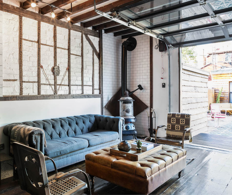 Lounge area with open garage door leading out of Urban Cowboy Brooklyn. These chairs and couch are just inside an area that leads out to our patio.